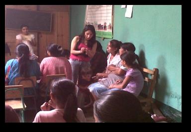 Cindy Villalobos teaching adults in a classroom.