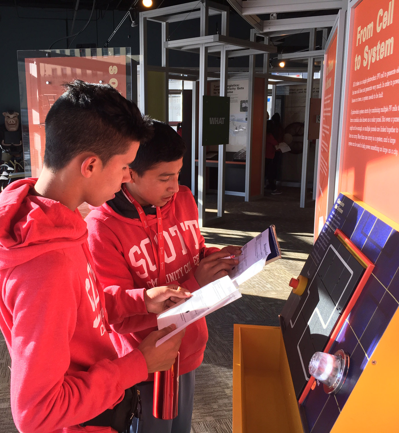 Two Youth Ambassador students looking at a display. students
