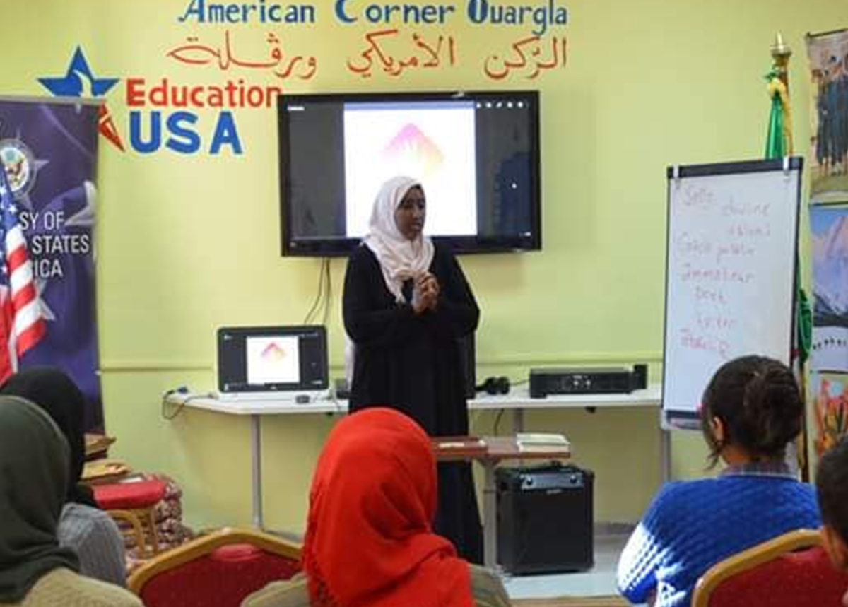 Bouchra Messaoudi speaks to students in a classroom.