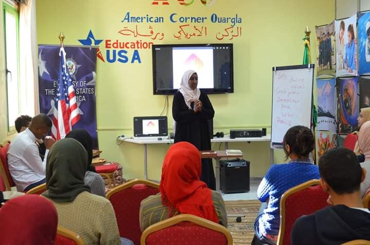 Bouchra Messaoudi speaks to fellow students in a classroom.