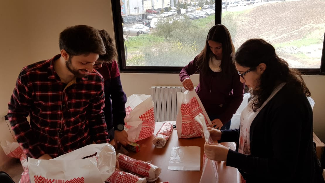 Rula Fakhoury with volunteers packing hygiene kits.