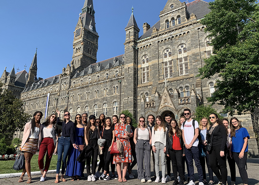 Gateway students in front of Healy Hall in Georgetown campus.