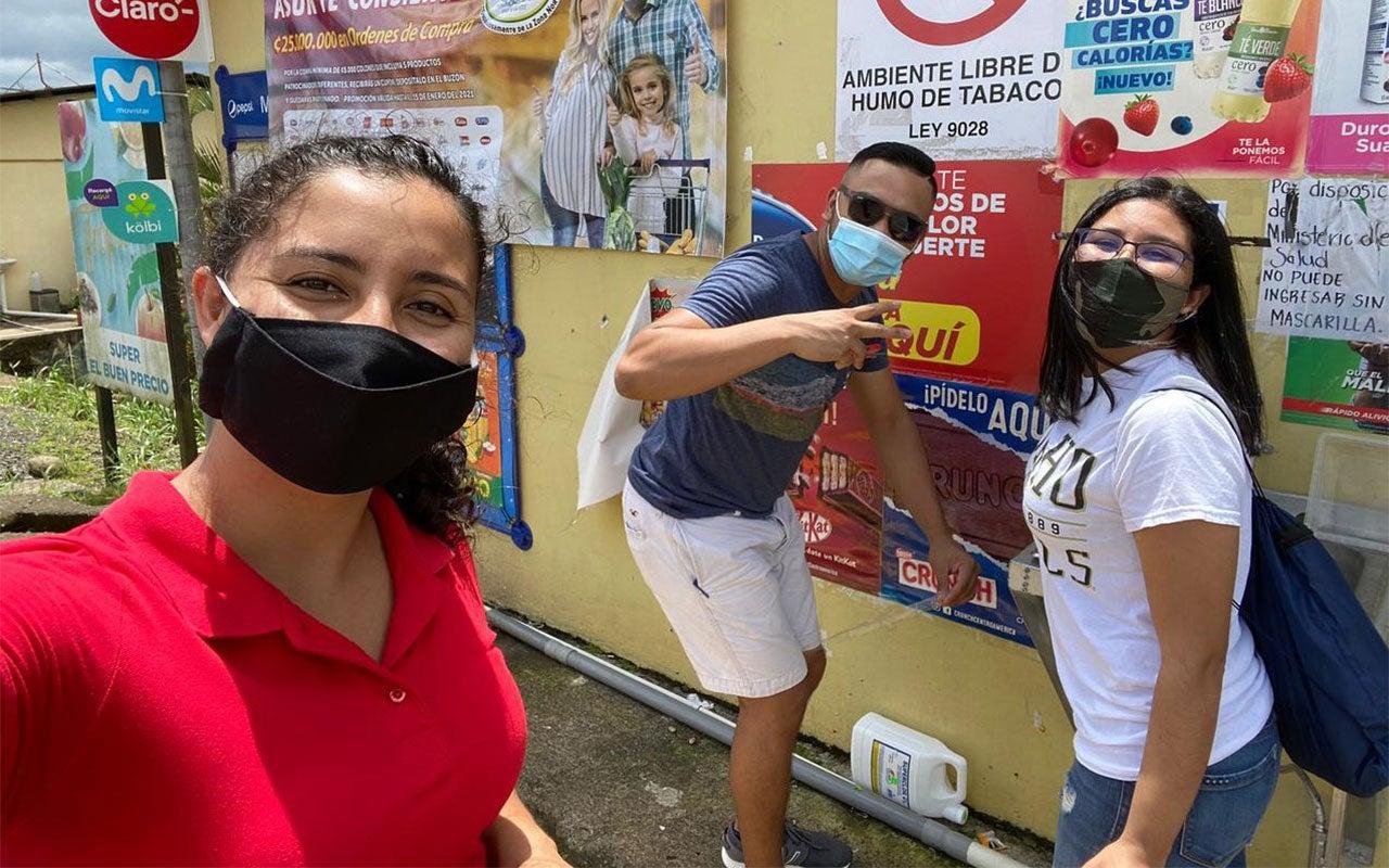 Three Youth Ambassador Alumni with masks